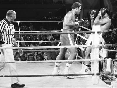 Foreman (left) being 'Rope-a-Doped' by Ali: 1974