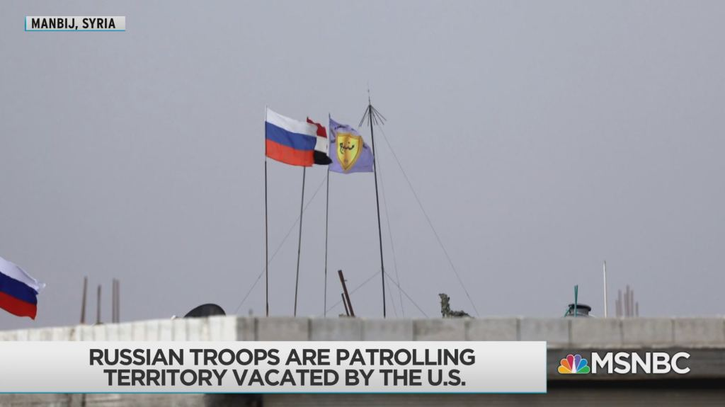 Russian & Syrian flags over US base