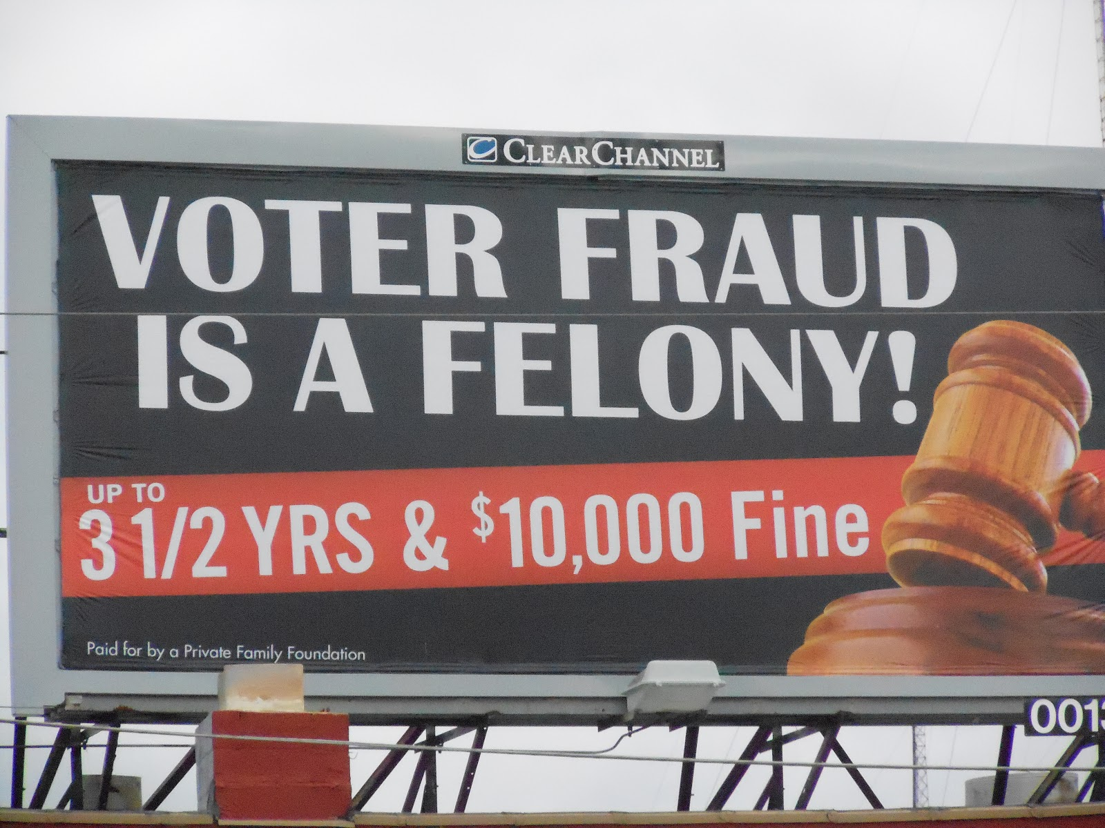 Threatening billboards in poor black neighborhoods